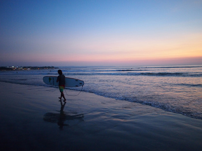 Surfer at sunset, Kuta, Bali – Indonesia